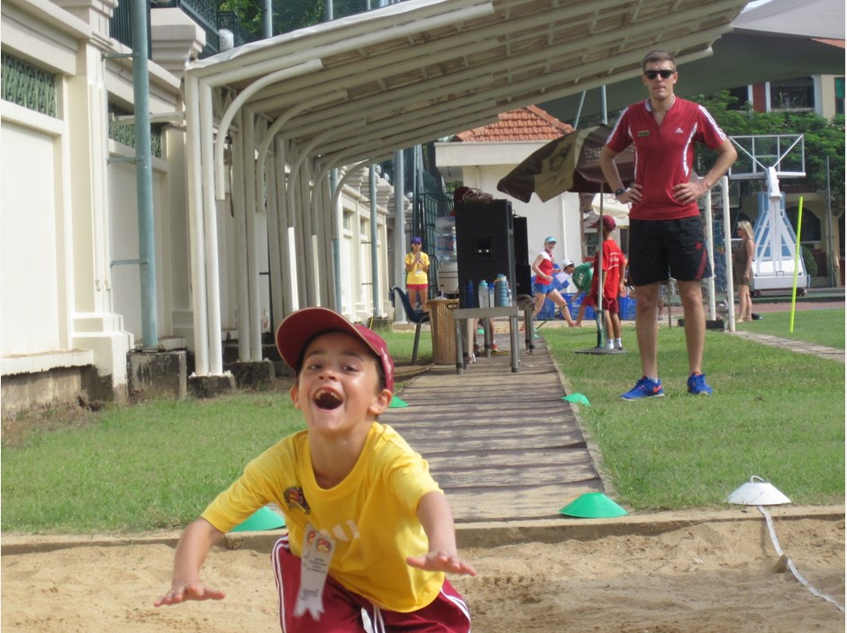 One boy in long jump competition