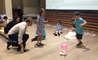 Key Stage 1 children at the British International School Shanghai work with their parents to make balloon powered cars.