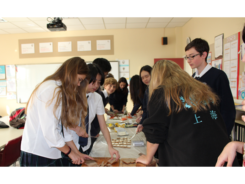 Students at the British International Schools Shanghai, Puxi take part in a cooking competition run by students