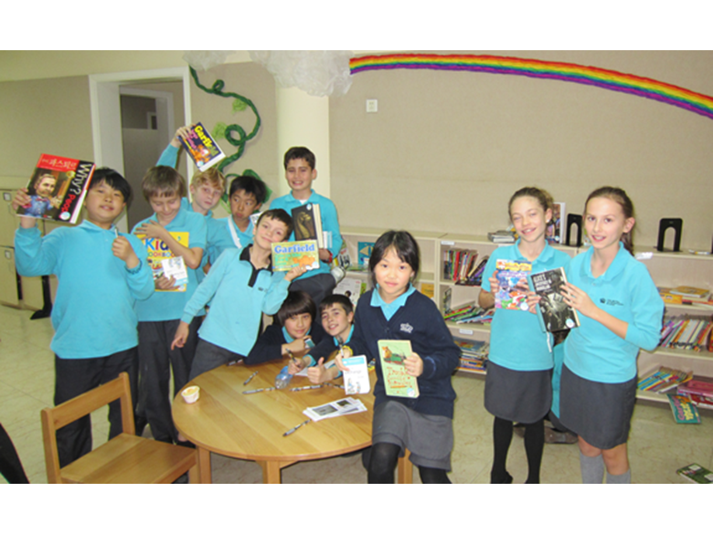 Key Stage 2 Students at the British International School Shanghai, Puxi get involved in the book eXchange.