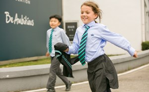Primary student playing outside
