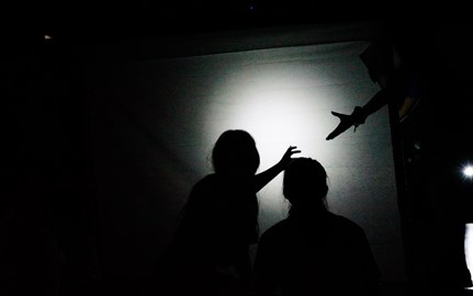 Students use light to create performance piece using shadows as part of the Juilliard Drama Specialist visit in 2019.
