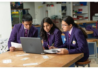 Secondary students on laptop