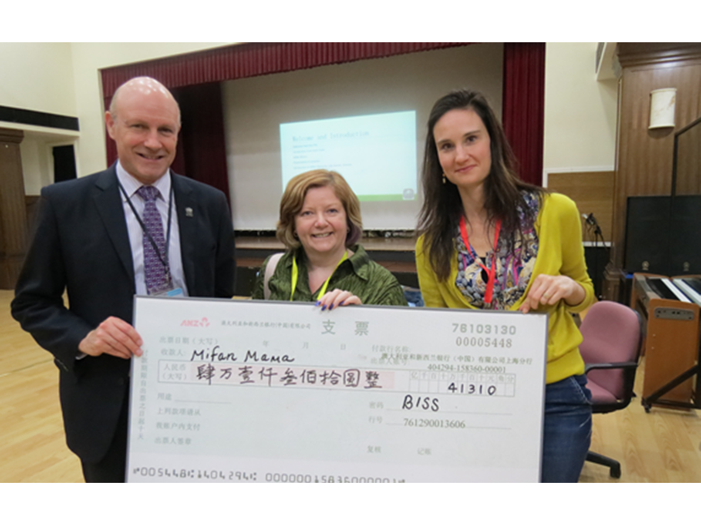 BISS Puxi PTA present donation to Mifan Mama