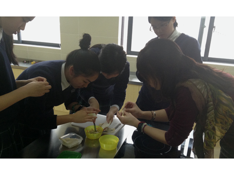 Students at British International School Shanghai making dumplings to celebrate Chinese New Year