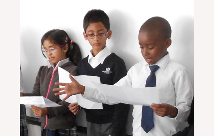 Children reading their poems to the class.
