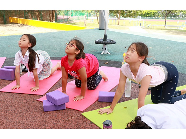Children Take Their Inclusive Yoga ECA Outdoors as They Perfect Their Poses and Breathing