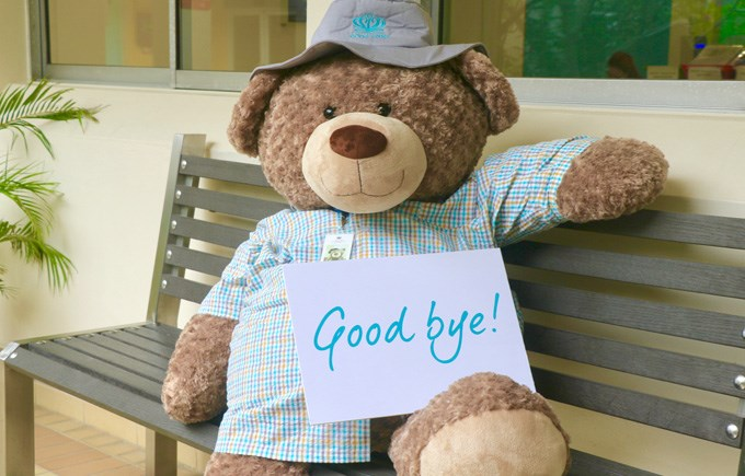 DC Bear with Good Bye Sign