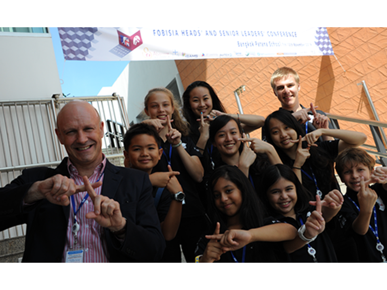 Our Principal at the FOBISIA Leaders' Conference with student ambassadors from Bangkok Patana School