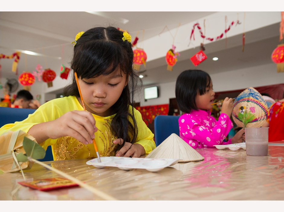 One girl drawing in Tet celebration's acitvities