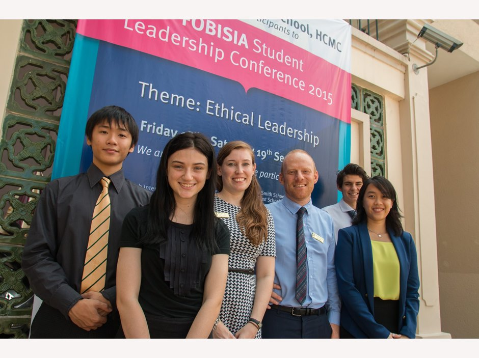 Teachers and students take photo in FOBISIA Student Leadership