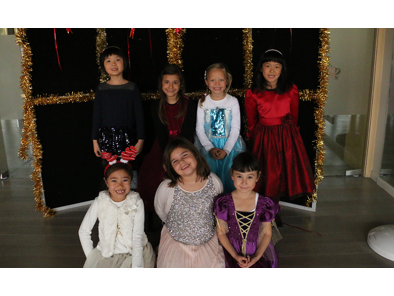 Primary students at the British International School Shanghai, Puxi celebrating Christmas with their annual Christmas parties.