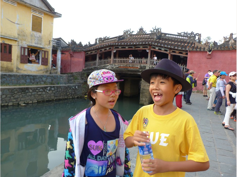 Students outside the Japanese Ancient Covered Bridge in Hoi An