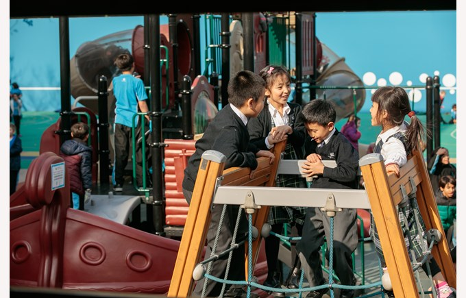 Students are having fun in the playground.