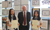 Carel Chok and Yvonne Huang receiveing their ABRSM certificates from Mr Foyle