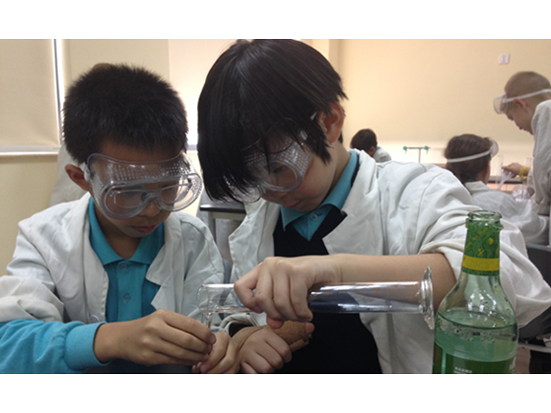 Year 5 students at the British International School Shanghai, Puxi experimenting in the new science labs.