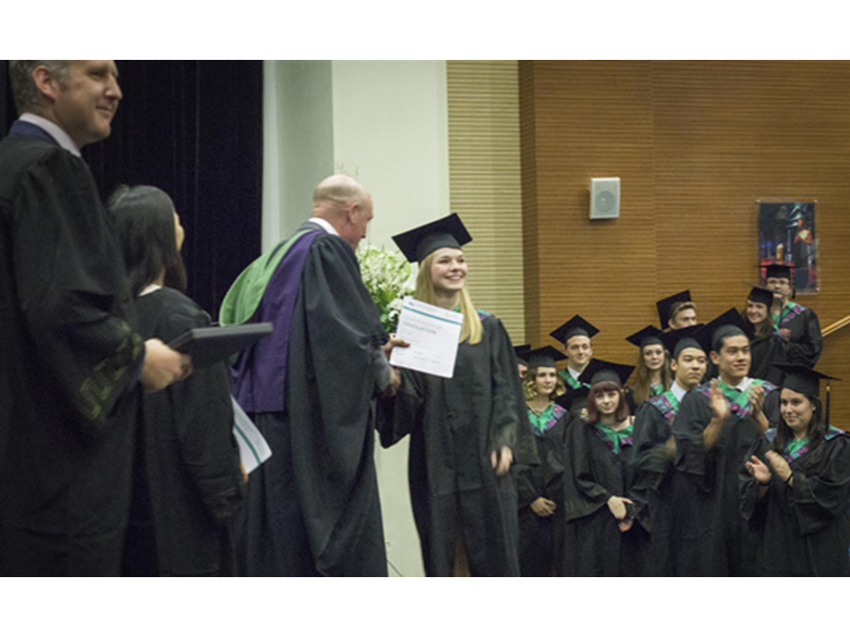 Graduates of the British International School Shanghai Puxi celebrate their graduation.