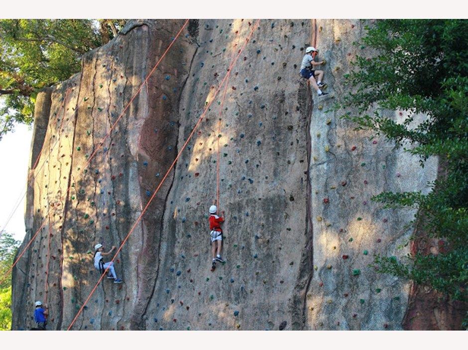 Students abseiling a steep rock face