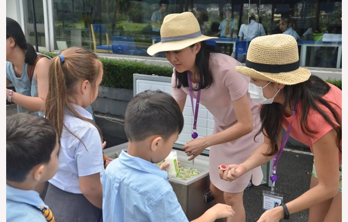 PPSG giving students ice cream on Children's Day