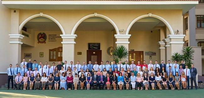 Formal APS Staff photo outside the main area of the secondary school