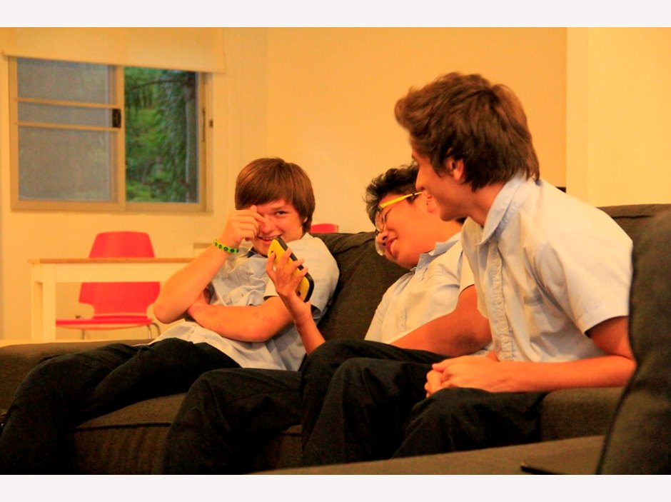 Boys in the common room of a boarding house