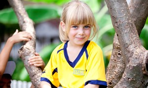 student blonde girl in tree