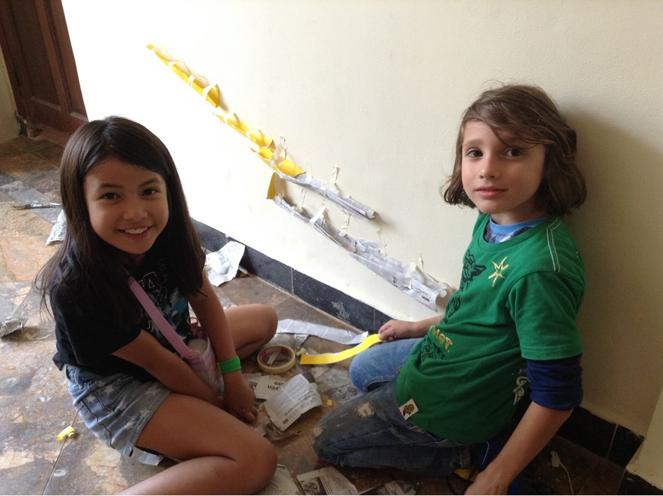Two girl sitting on the floor and smiling