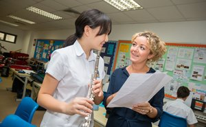 Music teacher with student