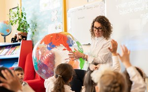 Teacher with globe