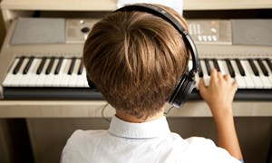 Boy Keyboard headphones Juilliard perfroming arts in action