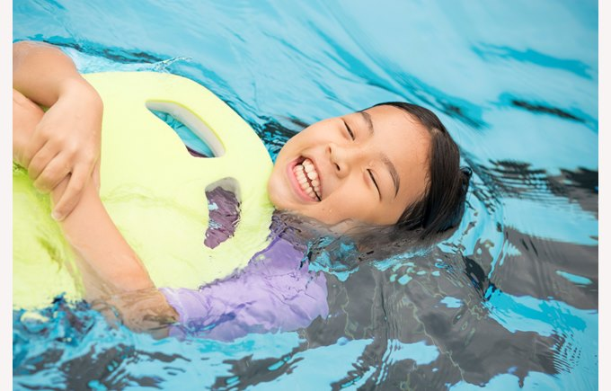 Primary student learning to swim.