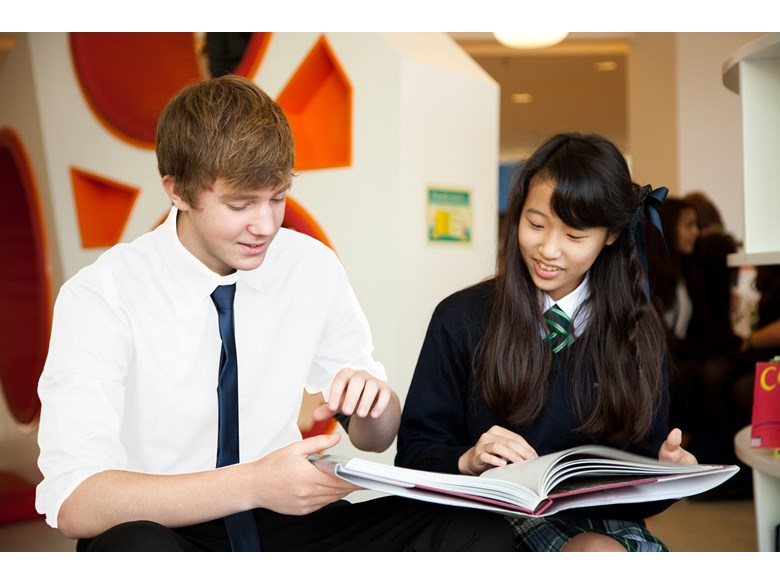 2 students reading resources
