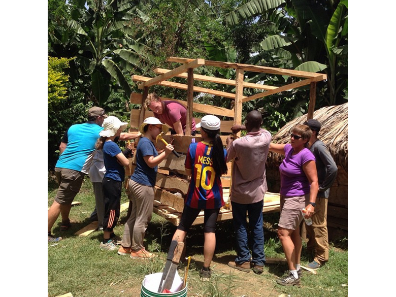 Students from the British International School Shanghai, Puxi campus building goat sheds in Tanzania
