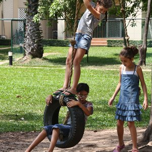 Children playing on rubber tyre