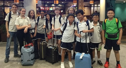 Students with their suitcases traveling to Cambodia