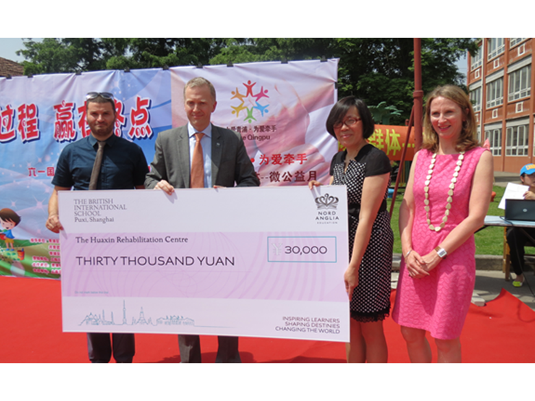 Money raised by BISS Puxi students is donated to Huaxin Centre