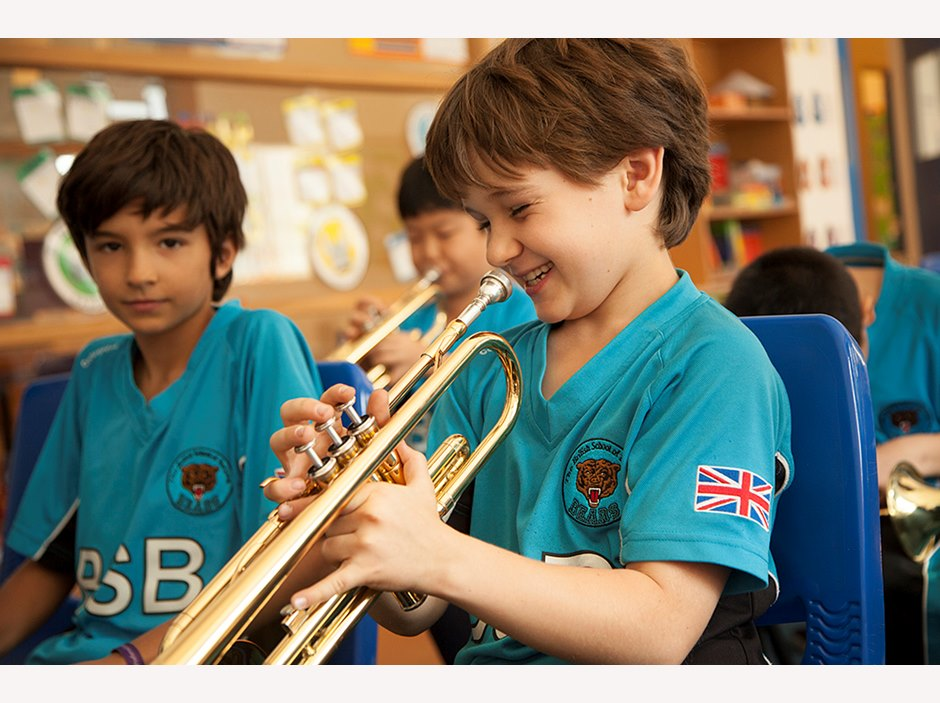 Class learning to play the trumpet.