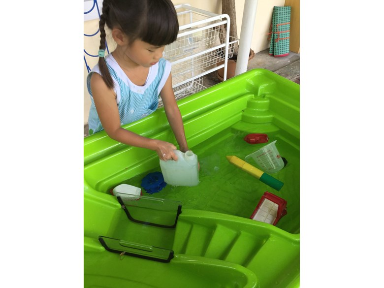 KS1 Student getting water