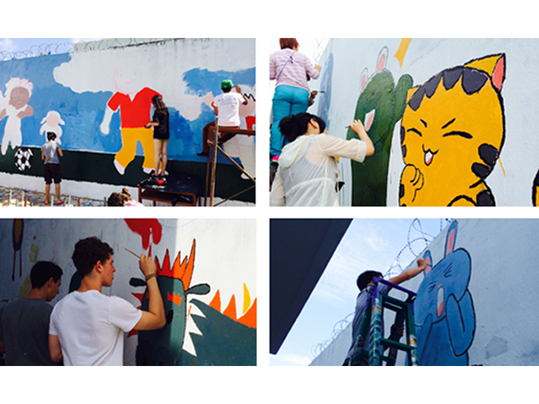Year 12 continuing to paint murals on school walls in Cambodia