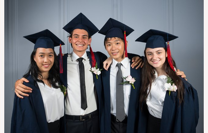 Four graduating students in gowns