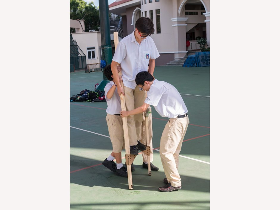 student walks on stilts