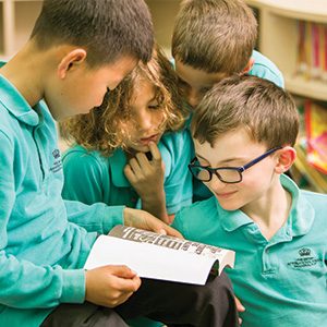 Young students reading book