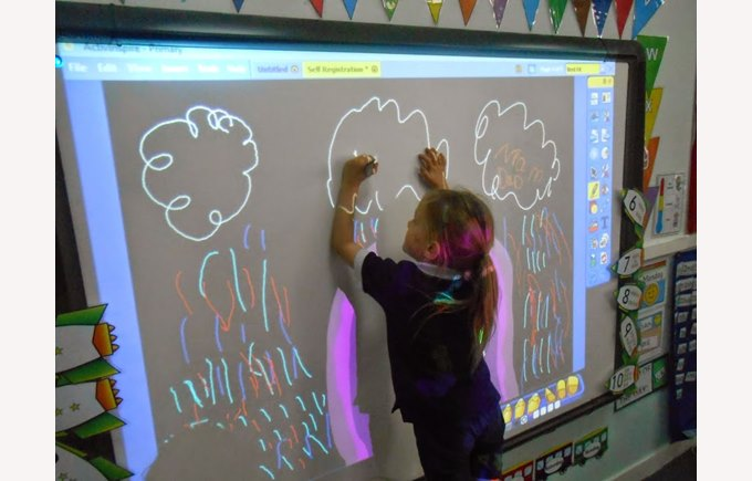 Reception Student drawing on an interactive white board