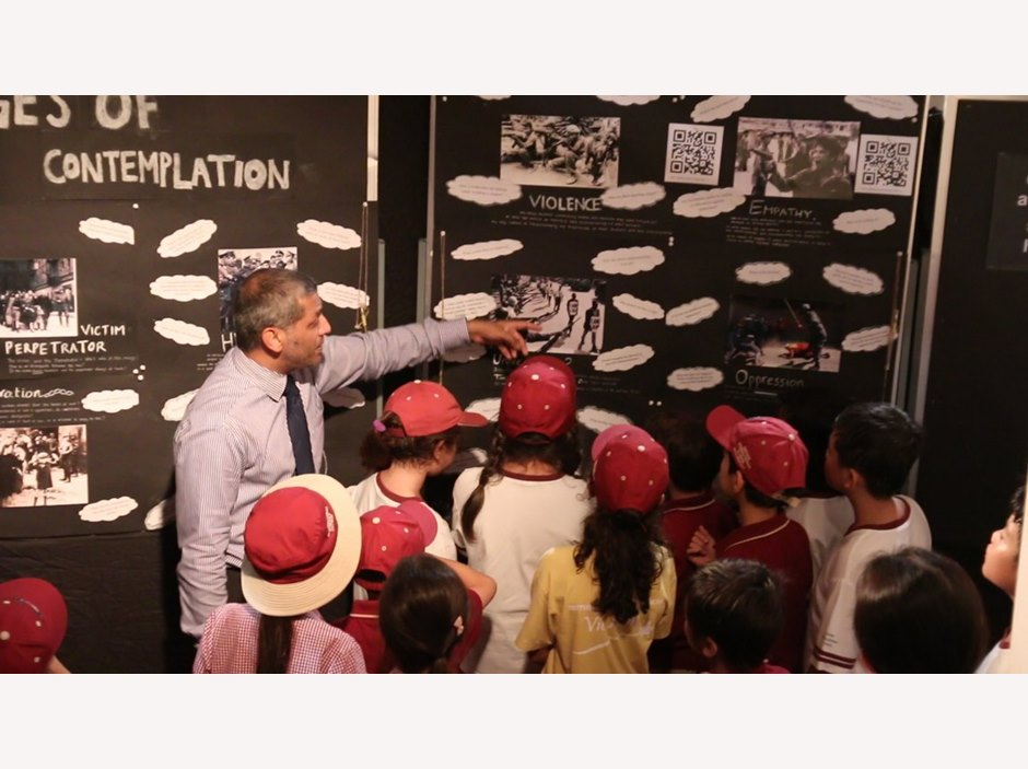 Teachers showing Anne Frank to primary students