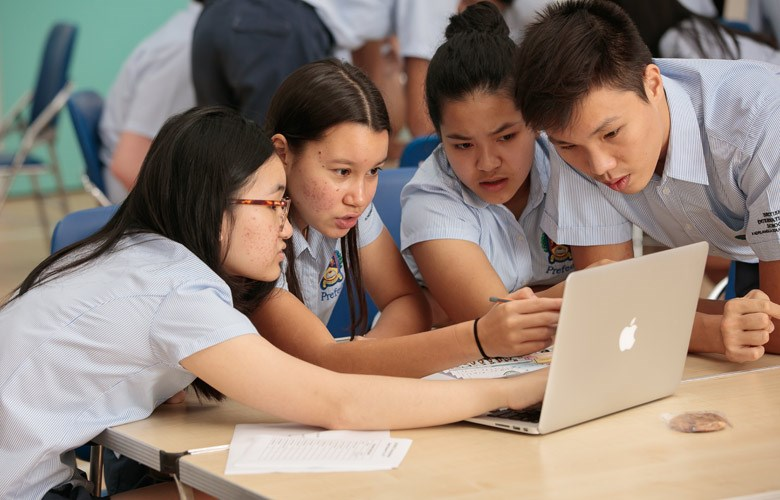 IBDP students working at computer | BIS HCMC