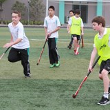Primary students playing hockey