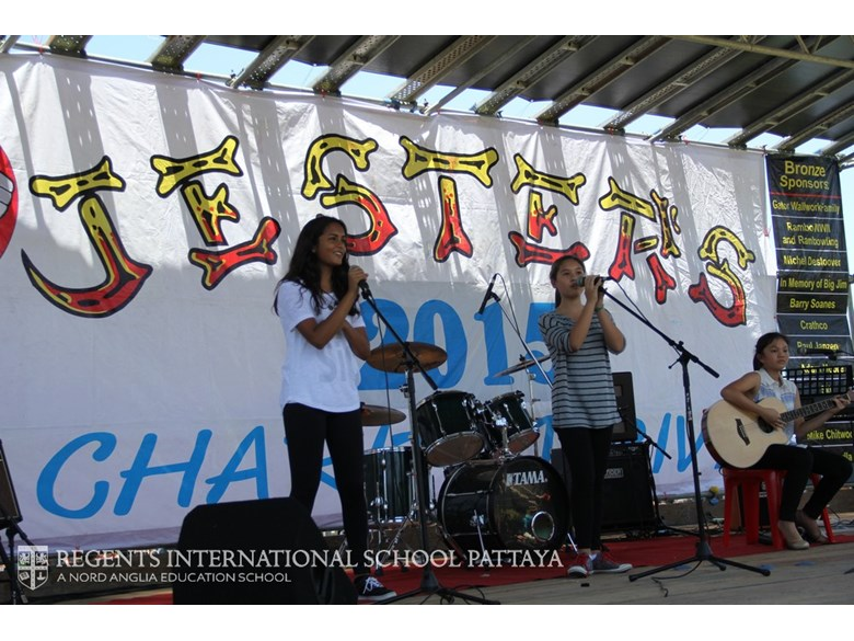 Music group/girl band onstage at Jester's Fair - Regents International School Pattaya