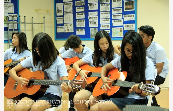 Students in a guitar lesson.