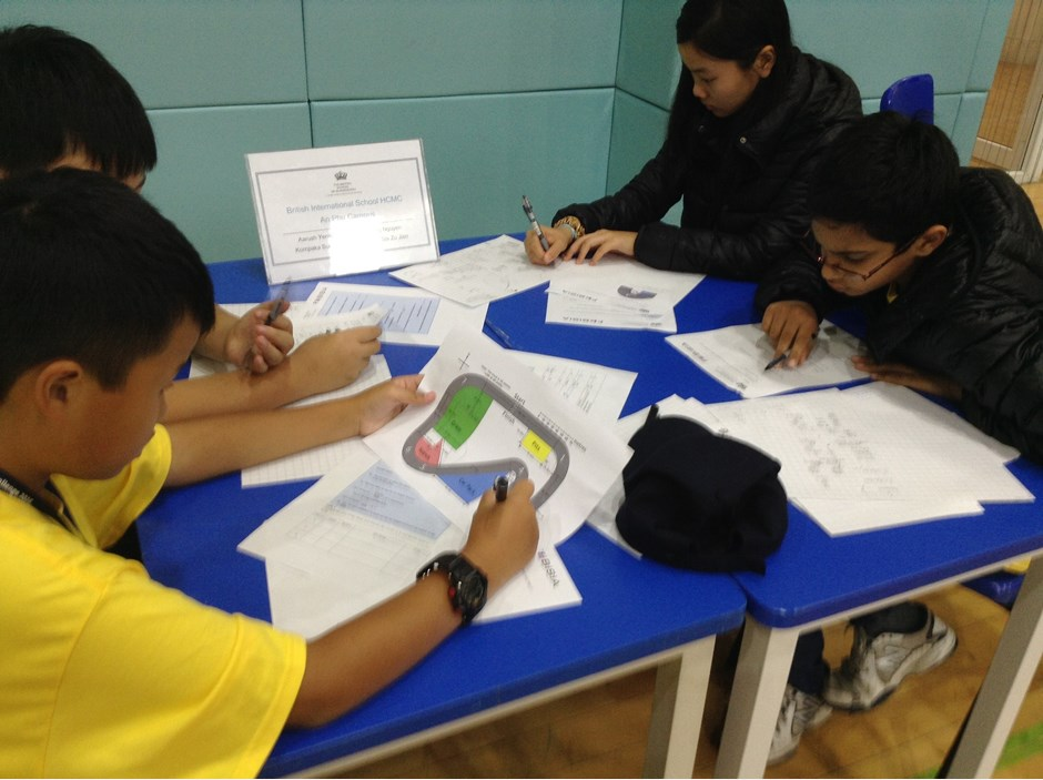 Four students solving mathematics problems