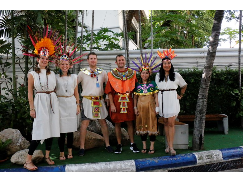 St. Andrews International School Bangkok teachers posing in traditional Aztec costumes.